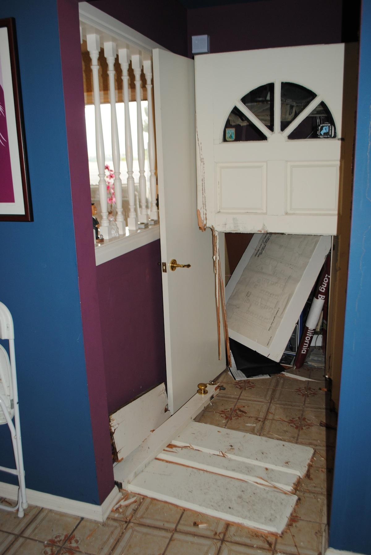 door smashed in by SWAT team